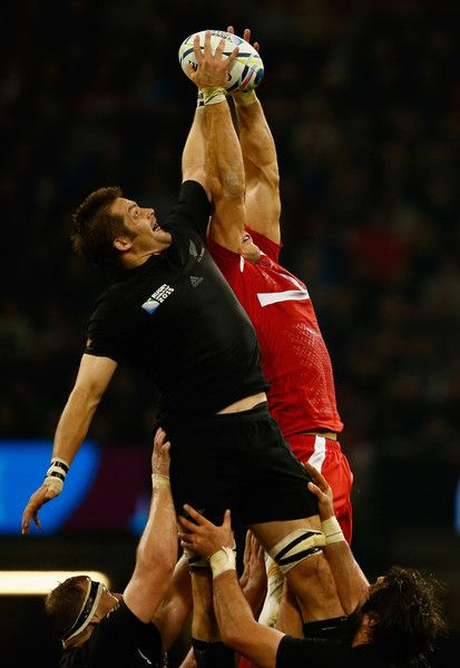 Richie Mccaw Photos Photos - Richie McCaw of New Zealand competes for a line out ball with Lasha Malaguradze of Georgia during the 2015 Rugby World Cup Pool C match between New Zealand and Georgia at Millennium Stadium on October 2, 2015 in Cardiff, United Kingdom. - New Zealand v Georgia - Group C: Rugby World Cup 2015