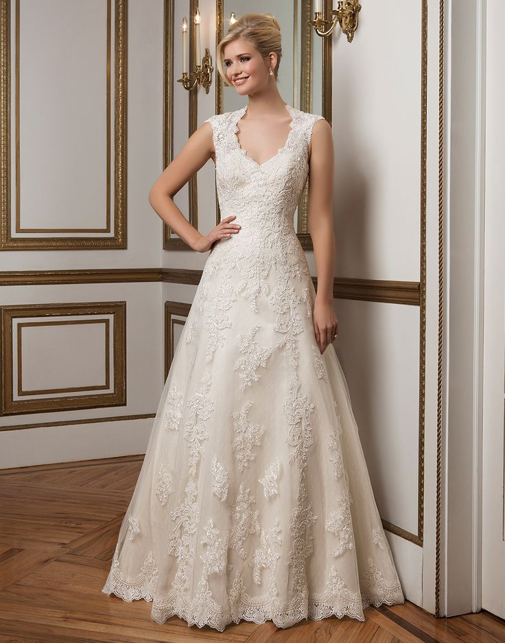 Justin Alexander wedding dresses style 8822 Classic A-line gown with a Queen Anne neckline features hand placed beaded lace and point d'esprit underlay. The illusion back was designed for the sophisticated bride.