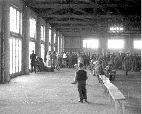 My mother Helena and I were here at DP Camp Delmenhorst Departure Hall, Bavaria, Germany. This picture taken in 1950 showing people getting ready to go to Naples, Italy. From Naples to Australia for resettlement.