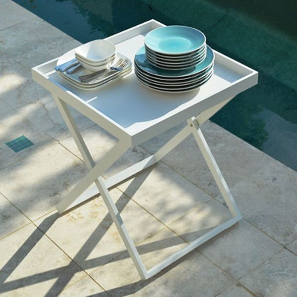 Servitor Butler Table. Butler table with detachable 60x60cm tray in white powder coated aluminium. A 2-in-1 side table and tray, the Servitore Butler Table is the perfect accessory to have in your home. Use it indoors or outdoors, for pool parties, dinner parties or for those lazy Sunday afternoons on the couch or by the pool. The Servitore is your solution for extra space for drinks, snacks or for that extra pot plant or candle.
