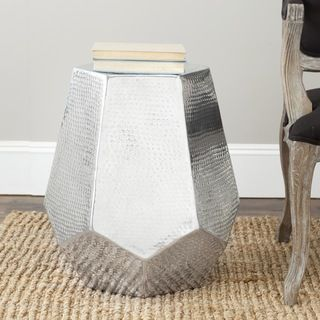 @Overstock.com - Safavieh Tantlum Silver Stool - Choose the Tantlum stool as a sophisticated accent for contemporary interiors. With graceful lines, shimmering tones, and an artful Deco vibe, the stool in polished aluminum will hold your flowers or cocktail.  http://www.overstock.com/Home-Garden/Safavieh-Tantlum-Silver-Stool/7388210/product.html?CID=214117 $101.24