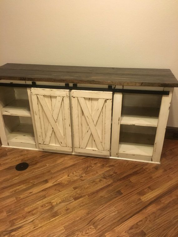 Looking for that perfect custom Media Console, TV Stand, Sideboard or Buffet? Check out our wide variety of handmade Media Centers custom built to fit your specific need. Although rustic in nature, our design style functions with your modern TV components and offers great storage!  If ur looking for a different stain, paint or size, feel free to contact me with any questions We can Customize this console to your specifications.  Details on the console: Dimensions: 36 High, depth and length…