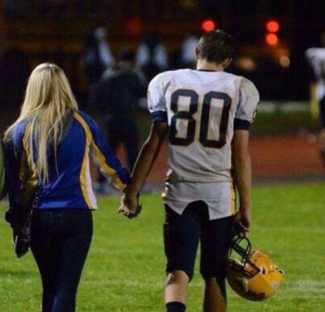 I love this picture! The best part about football is seeing your man go out there and play and then being able to see him after the game ❤️ #footballcouple