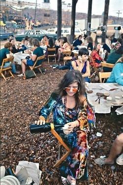 Janis Joplin pours herself a drink at Woodstock