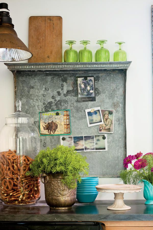 a salvaged metal radiator cover thats equipped with magnets hangs as the kitchen bulletin board - Kitchen Bulletin Board Ideas