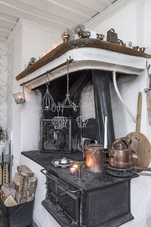 Swedish kitchen with vedspis / wood cooker.