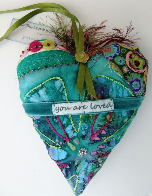 stuffed embroidered quilted heart.  Love the blue green.