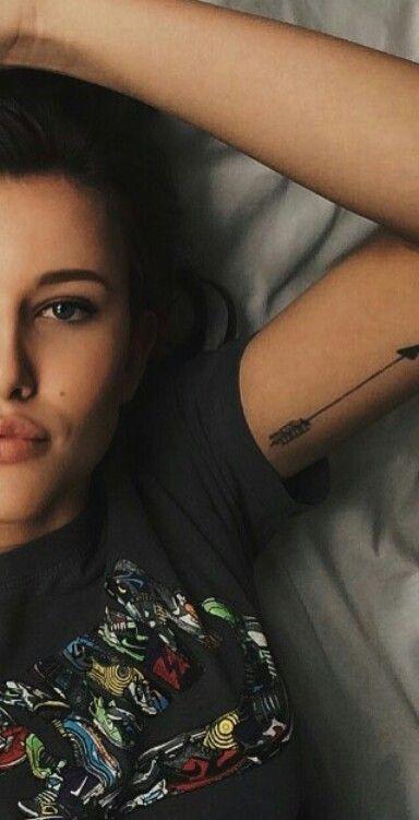 CelineKoningstein arrow tattoo arm