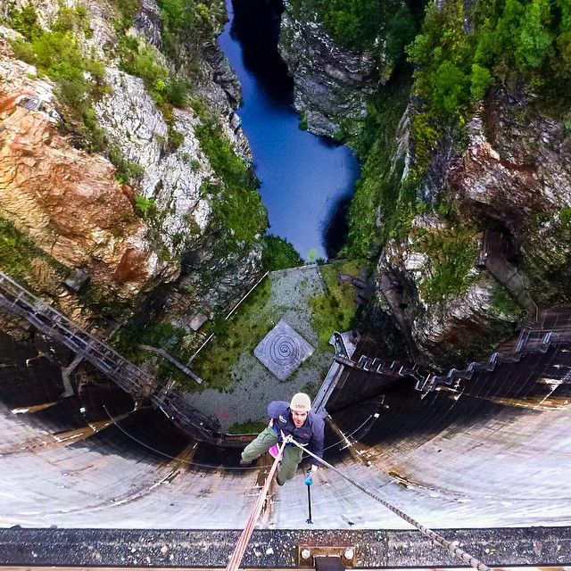 Abseiling down the Gordon Dam at Strathgordon. This is the world's highest commercial abseil - 140m (460ft) straight down the dam wall into Tasmania's Southwest wilderness. What a rush! #abseiling #tasmania #strathgordon #discovertasmania Image Credit: Graham Michael Freeman