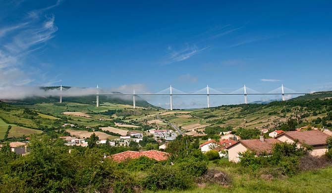 The Millau Viaduct (French: le Viaduc de Millau) is a cable-stayed bridge that spans the valley of the River Tarn near Millau in southern France.    Designed by... Get more information about the Millau Viaduct on Hostelman.com #attraction #France #landmark #travel #destinations #tips #packing #ideas #budget #trips