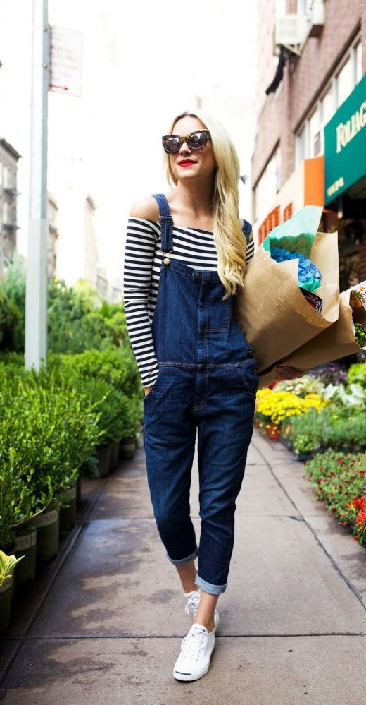 striped top with overalls and sneakers