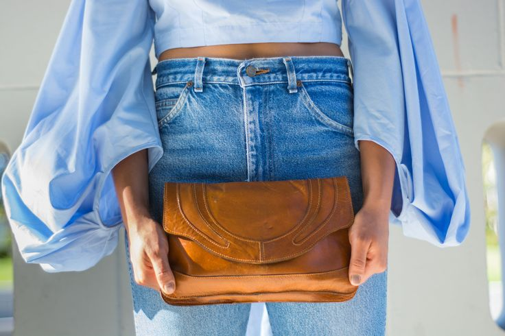 Bell Sleeves, Denim Jeans, Brown Chunk 90's Heels. Brown Clutch Bag. Outfit for day events. More on navigatingthis.com.