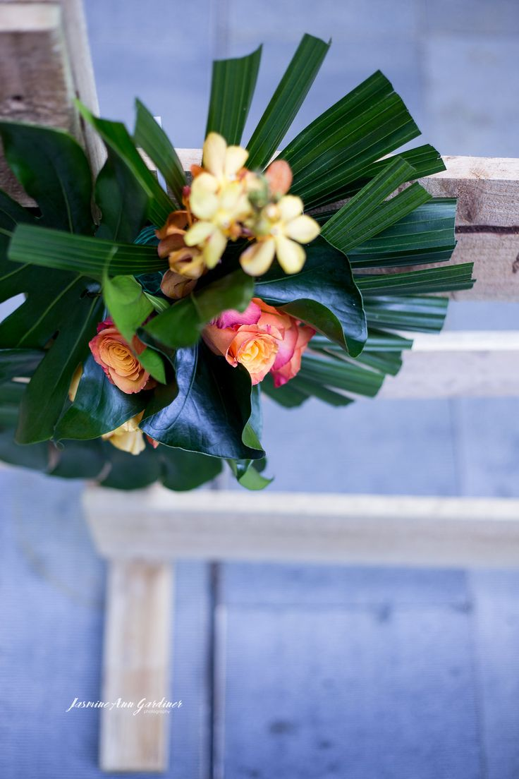 DY.o events (aka Duo)  Melbourne Cup Floral decoration to fence line. Event design and florals.