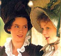 Emma (Kate Beckinsale) in a scary hat,  with Mrs. Weston (Samantha Bond) in  a ladylike bonnet.