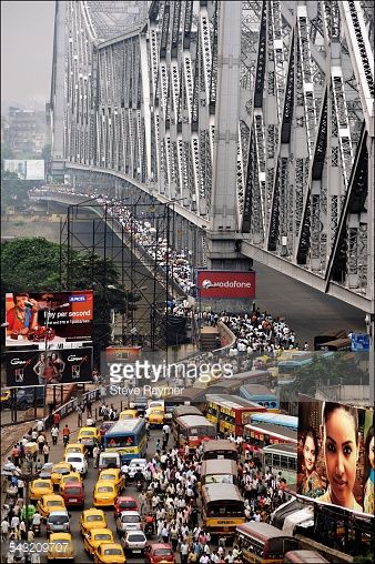 Gateway to Calcutta, the 269-foot-high, or 82-meter-high, Howrah Bridge carries more than 100,000 vehicles and at least a half-million pedestrians across the Hooghly River daily easily making it the busiest cantilever bridge in the world.
