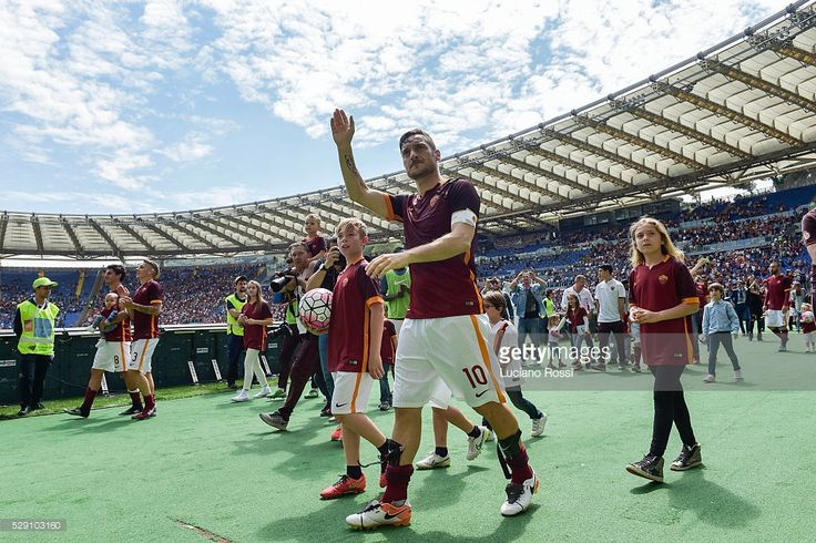 AS Roma captain Francesco Totti greets his fans after the Serie A match between AS Roma and AC Chievo Verona at Stadio Olimpico on May 8, 2016 in Rome, Italy.