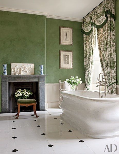 The bath of Easton Neston's Empress Suite—named in honor of Empress Elisabeth of Austria, who rented the estate in 1876—is anchored by a marble tub with Lefroy Brooks fittings.   archdigest.com