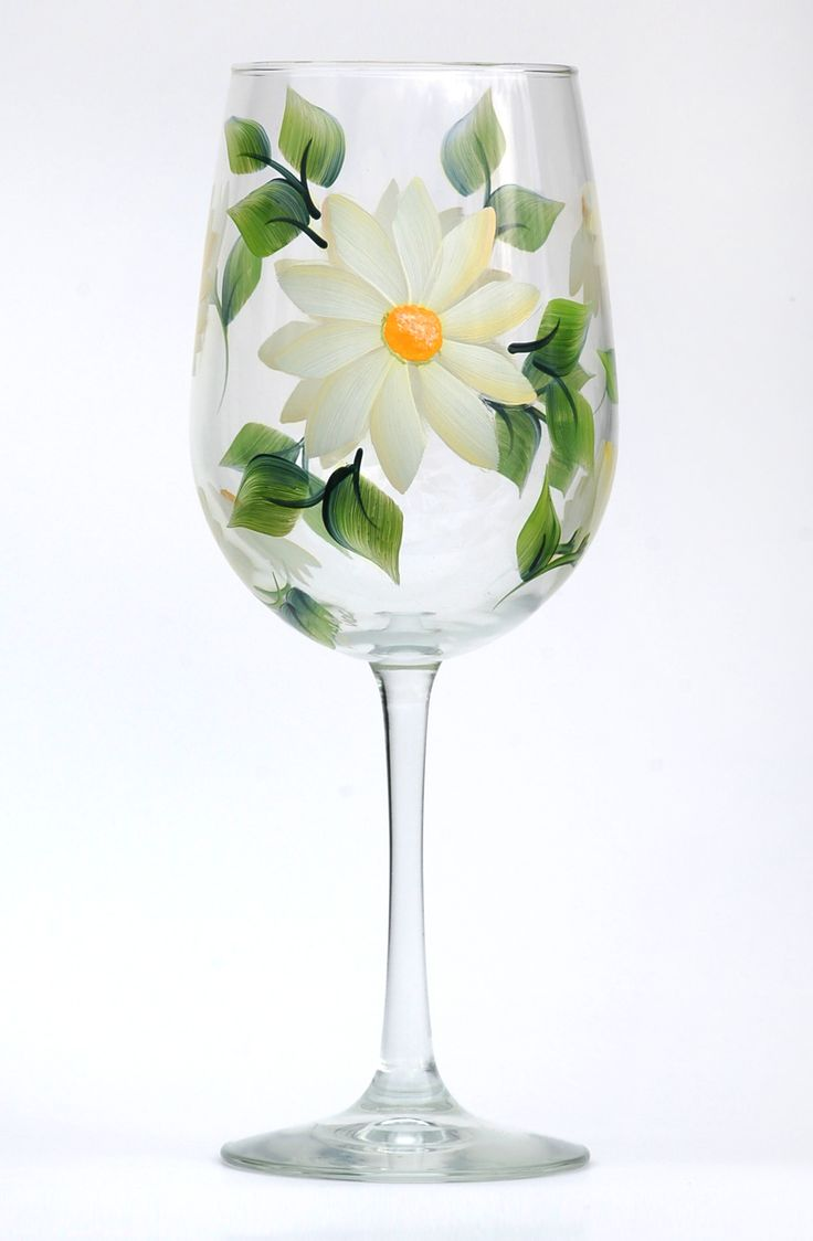 Creamy white daisy petals with soft yellow shading, yellow centers and deep green leaves hand-painted on quality 18.5 ounce wine glass.