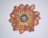 Yellow felt flower brooch with wool threads