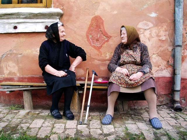 In the most villages in Serbia, people like to sit on the bench in front of the house if they have nothing to do. Almost every house in those old villages has a bench. People sit there and gossip about different things...