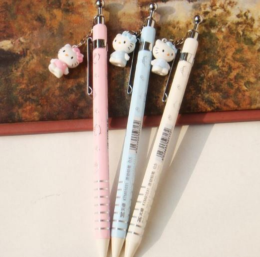 Cute little Hello Kitty Charm Mechanical Pencils features pink, white, and blue pencils with a little charming Hello Kitty pendant dangling from above the barrel. The pencil barrel has shiny silver im