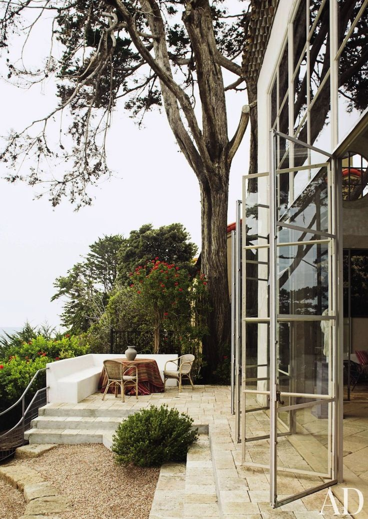 stone terrace, steel window frames | designer Richard Shapiro's Malibu house