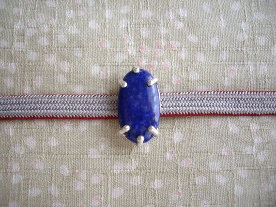 This is kimono obi accessories called obidome. Add jewelry on your kimono coordination. This obidome is very simple and unique! I set stone simply with prongs. It looks like a star. Perfect gift for someone loves kimono.  Materials used: Lapis lazuli Sterling silver  size 1.1x 0.6 (3 cm x 1.7 cm)  please use with sanbuhimo (slim type obijime)  Find more obidome from Wayoko https://www.etsy.com/shop/WAYOKO?section_id=13414666&ref=shopsection_leftnav_5  Please ...