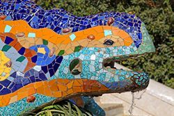 "Dragon Fountain:One of Gaudi's most interesting sculptures is a fountain named ""the Dragon"", symbol of fire and alchemy.   It's located underneath the terrace of Park Güell, and at the top of the major stairs."