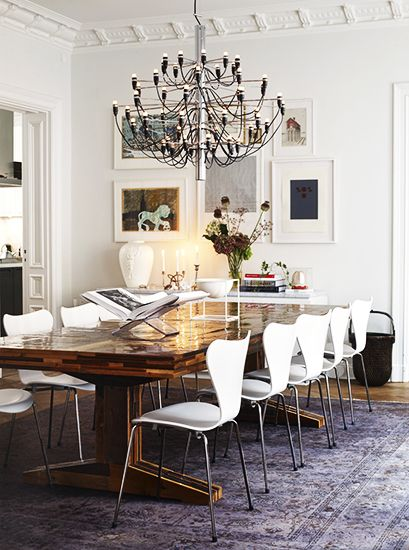Tour the Most Beautiful Townhouses with Modern, Eclectic Style// modern dining chairs, crown molding, Gino Sarfatti chandelier