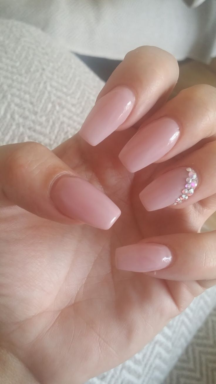 Long pink nails with diamond design