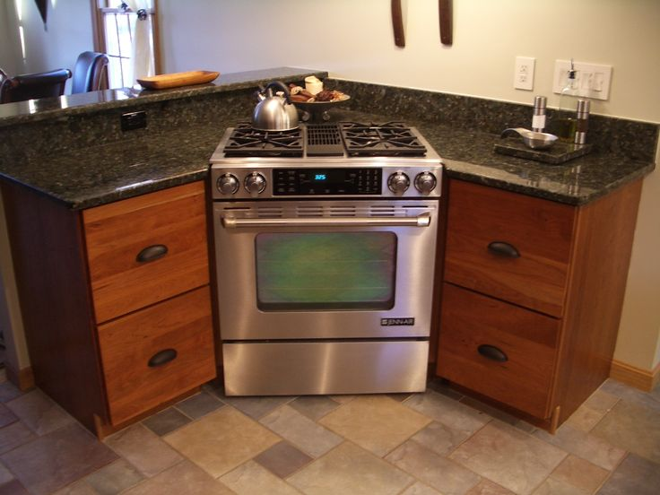 Cherry cabinets Kitchen cabinets stainless steel range