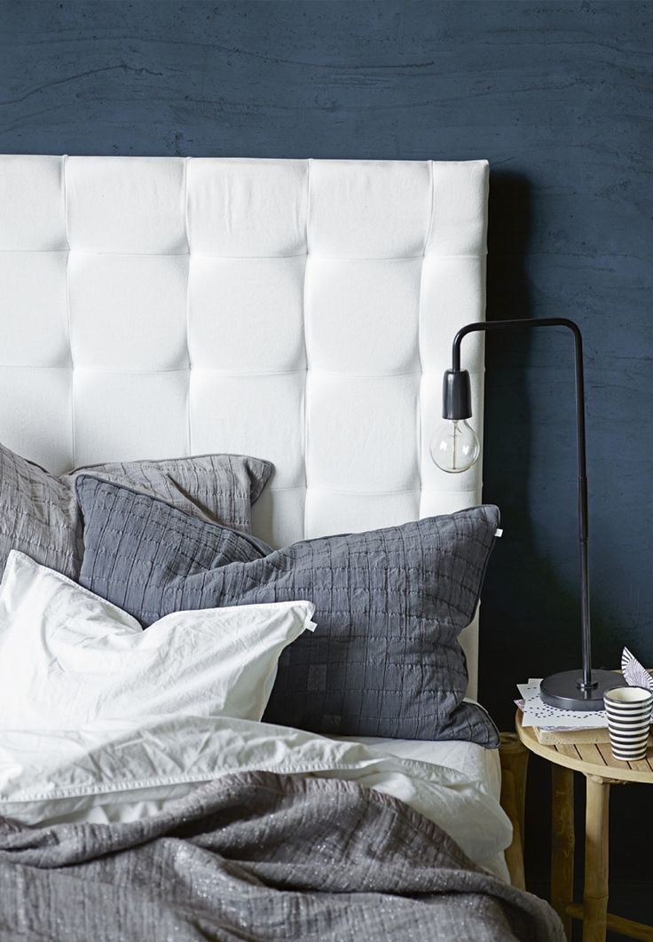 White wall mounted bed headboard in quilted cotton canvas from Tine K Home.