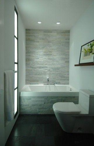 Stone wall in the bathroom. Nice.