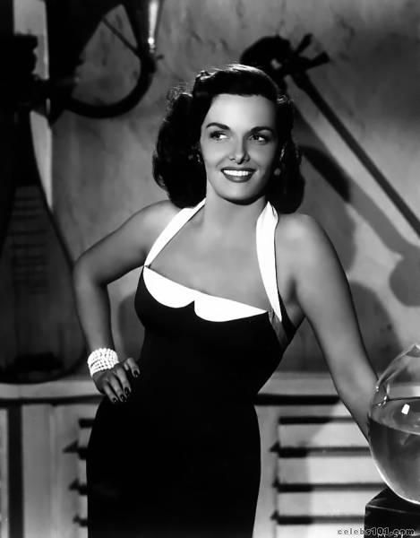 Jane Russell appears here wearing a black and white halter neck dress.  I find this style interesting because it gives the illusion of a sweetheart neckline without actually having one.  Very cool style.