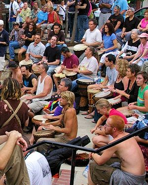 Friday night drum circle in asheville NC. The town has embraced and nurtured the free gathering since 2001 and the free  rhythm party has grown and now folks come from all over to visit the down town park fest & join in the fun.  Can you find my dad in this picture?!?! Hahaha!