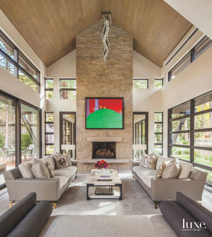High Vaulted Ceiling Living Room With Stone Fireplace And