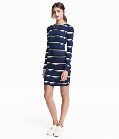 Short, fitted dress in ribbed jersey with long sleeves.