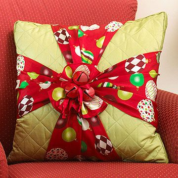 Seasonal Fashion   Give an ordinary pillow a touch of Christmas style with holiday-theme silk scarves. Wrap scarves around a pillow to resemble a package, and tie the ends together in a pretty bow. Hand-stitch the bow to the pillow to secure if desired. Use red satin ribbon to tie large red jingle bells to the center of the bow. Knot the ribbon ends and trim with scissors.
