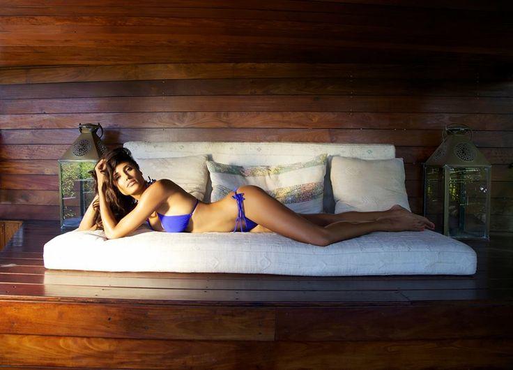 Bahamian Model Jeanene Fox Lounges Lazily On A Wooden