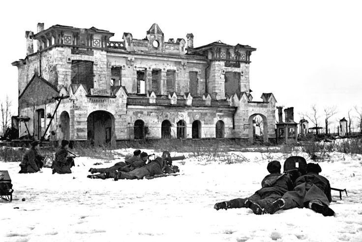 Soviet soldiers take up positions in front of the Detskoye Selo railway station in Pushkin during the Leningrad-Novgorod strategic offensive. After two weeks of fighting, the Soviets regained control of the Moscow-Leningrad railway, and on 27 January 1944, the 872-day Siege of Leningrad was finally lifted & German forces were repelled from Leningrad Oblast. Pushkin, Leningrad (now, Saint Petersburg), Russia, 21 January 1944.