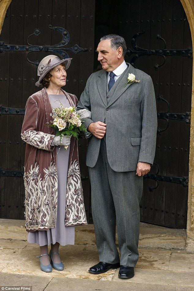 Besotted: The butler and the head housekeeper made for a dapper couple as they posed for pictures