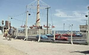 Photo from Holdfast Bay History Centre. The Glenelg sideshows, very popular spot during school holidays.