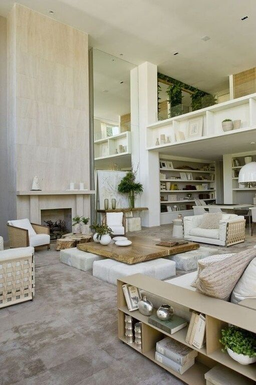 Two story living room dominated by full height mar…