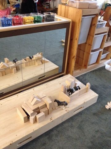 A Reggio Emilia-Inspired Classroom using a mirror in the block play area so children can see themselves while building.  This also allows children to easily see their constructions from all angles. #Reggio #Reggio Emilia #reggio emilia ideas #reggio classroom #reggio art