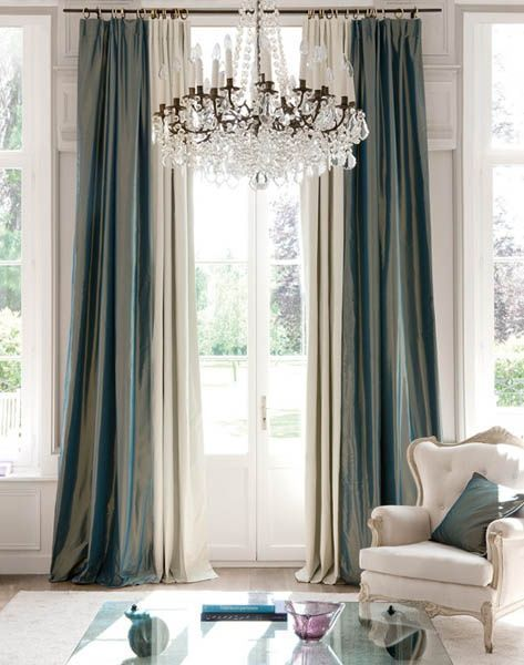 Pretty silk draperies in this roomgorgeous chandelier too