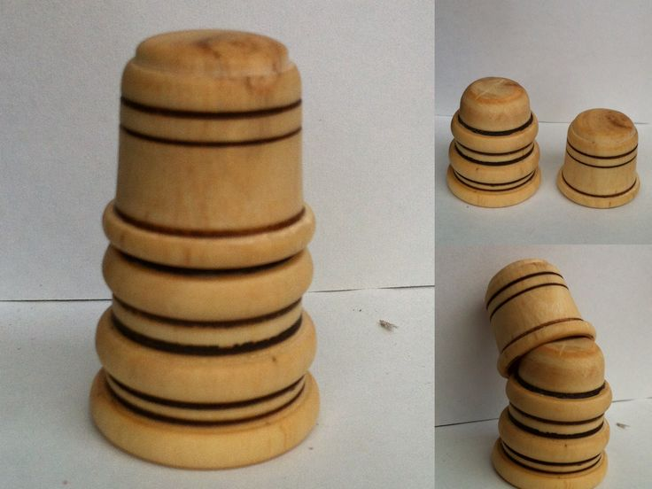 Madera de olivo. Dos dedales encajados. Realización artesanal.