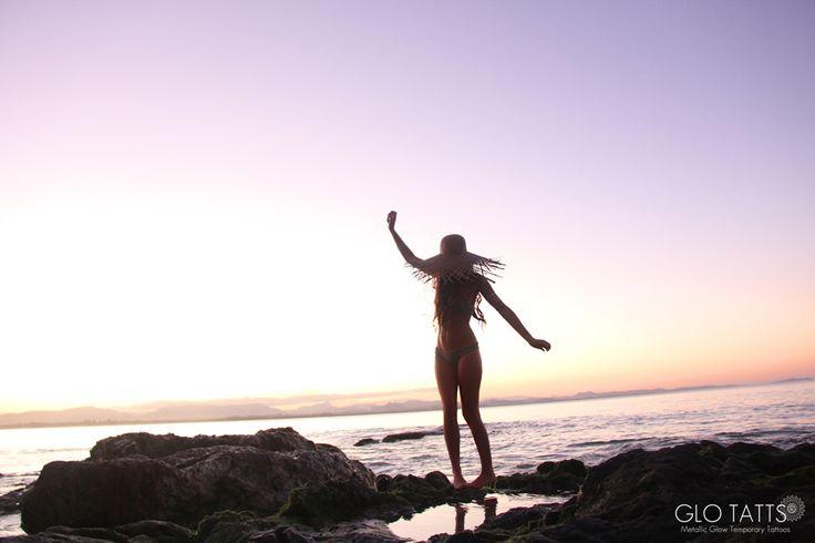 GLO TATTS flash tattoo lack of color straw hat crochet bikini Byron Bay sunset
