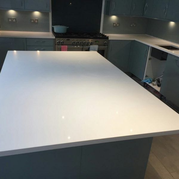 This kitchen has been designed with the Bianco De Lusso. It is a sparkle effect style quartz  that is a perfect contrast for any type of kitchen. It especially goes well with this high gloss teal traditional kitchen.