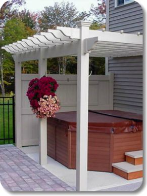 Vinyl Pergola with jacuzzi attached to the side of the house