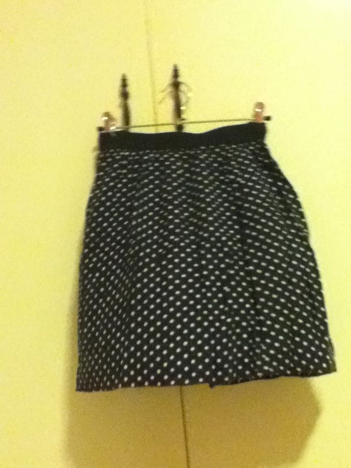 6 - navy blue, white-spotted skirt. size 12, girls express (equivalent to an 8 in ladies approximately).